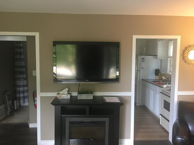 Living room with Cable TV and Fireplace