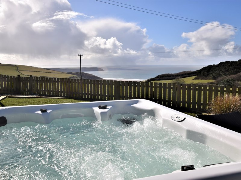 Sit back and relax in the hot tub whilst enjoying the idyllic sea view