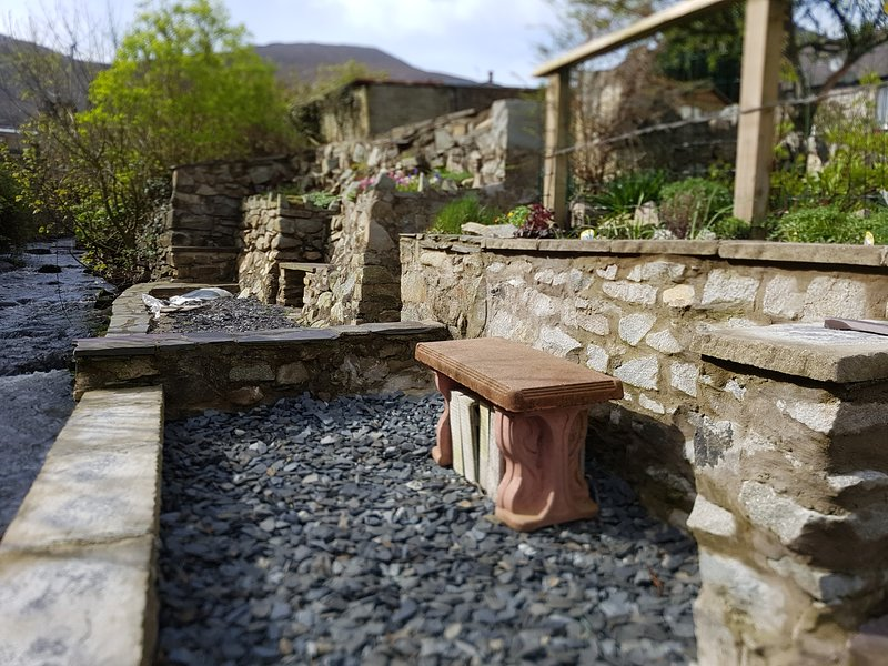 Stone cottage with private river terrace at the bottom of the long garden