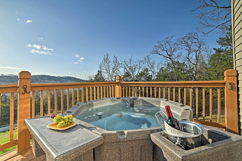 Take a relaxing soak in the private hot tub under a starlit sky.
