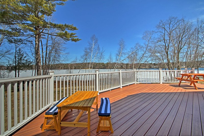 Fall in love with lakefront views at this Laconia vacation rental property!