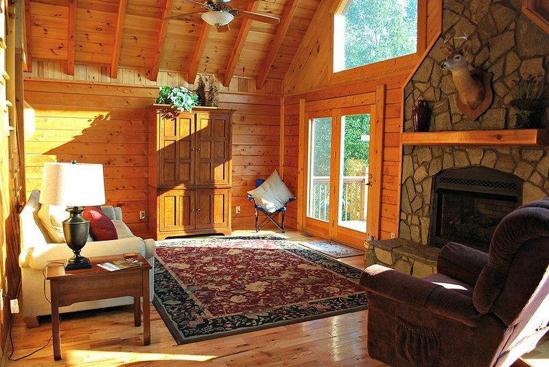 Living Room w/Fireplace and Deck Access