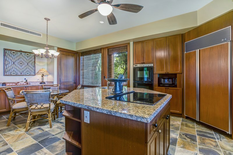 Alternate View of Kitchen with Cooking Island with Decor Range