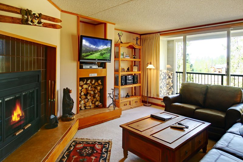 Unwind with the wood fireplace and TV
