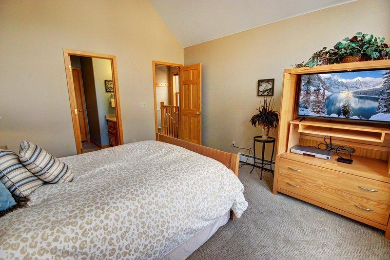 Chambre à coucher principale et salle de bain