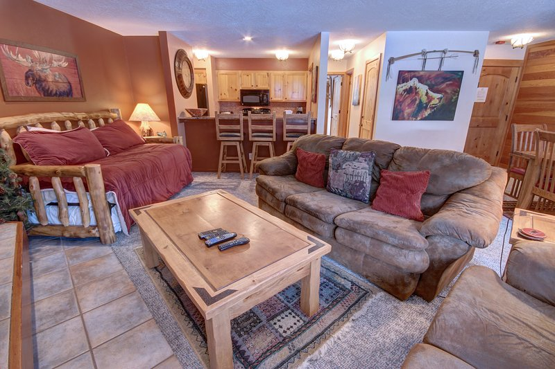 living room area with daybed and trundle bed to sleep your extra guests that come along for your vacation.