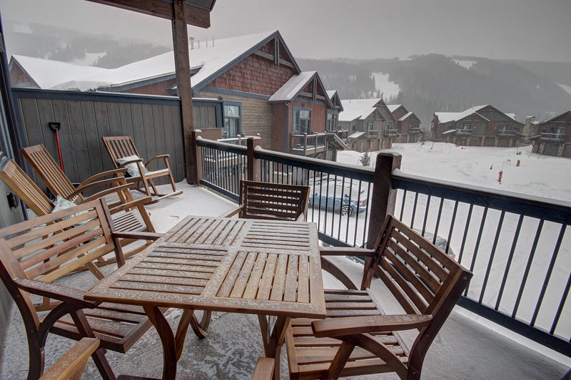 Great patio off the living area for grilling and watching the skiers come down the mountain side.