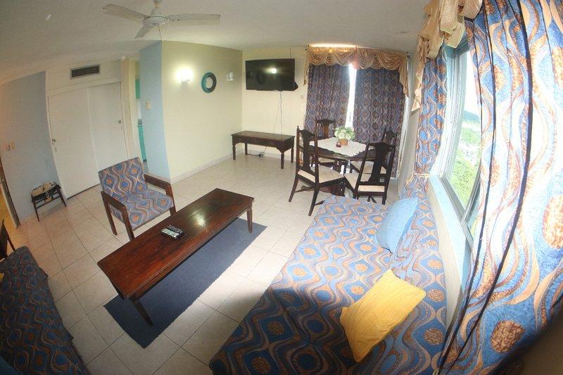 Salon et salle à manger avec 2 lits de jour
