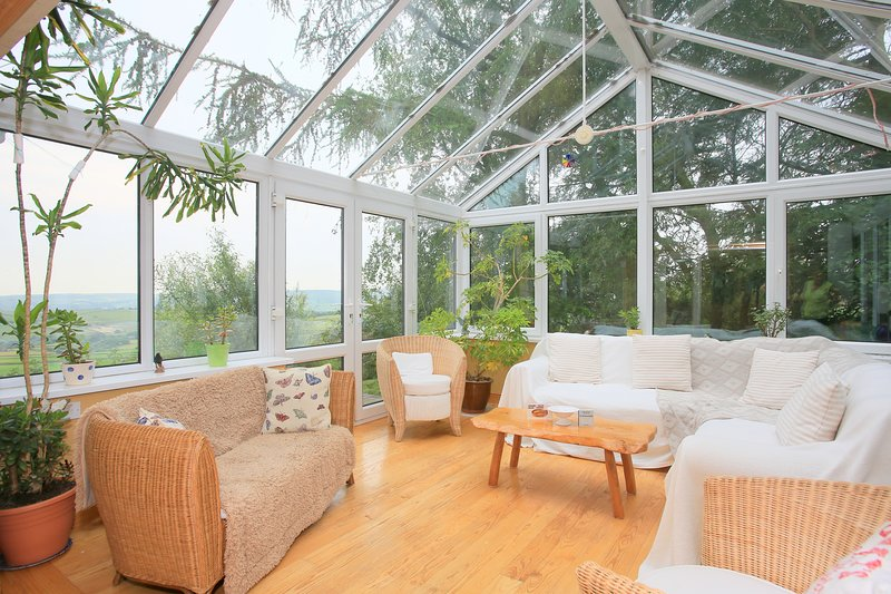 Relaxing with stunning views: the large conservatory