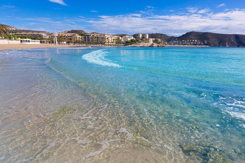 Crystal water on the main Moraira beach