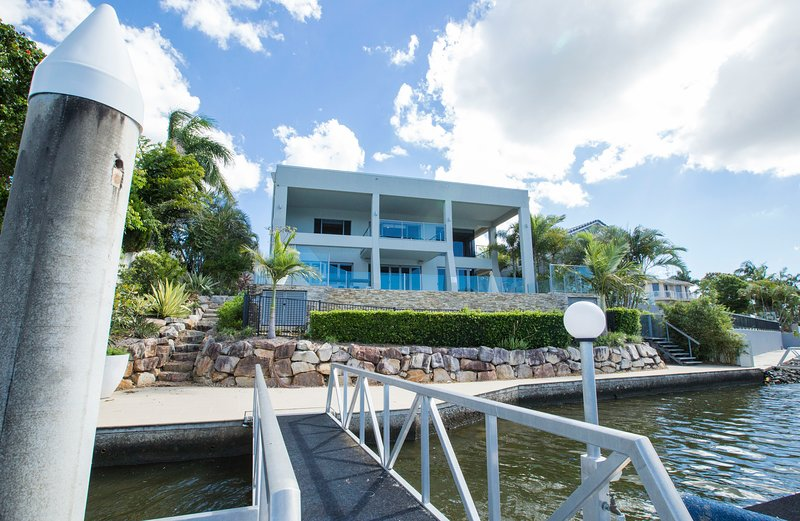 Exterior of waterfront house and access to private deck