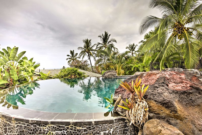 Soak in the private pool surrounded by palm trees and tropical landscaping.