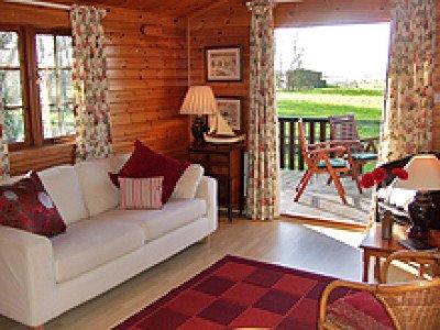 White Kemp has lovely views across the fields, ad a large deckto enjoy al fresco eating!