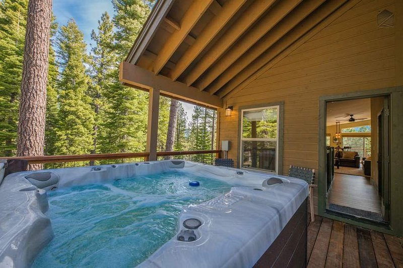 Gaze into the pines as you unwind in your private, second-floor hot tub.