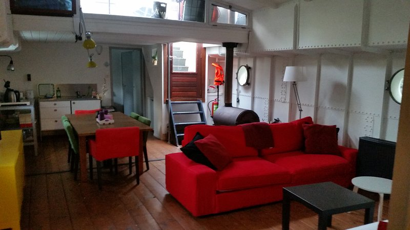 sala de estar y entrada
