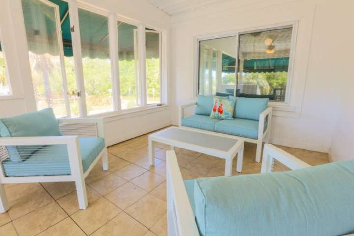Enjoy your morning coffee on the covered porch's lounge chairs.