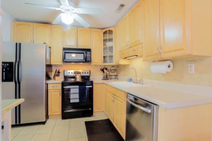The kitchen has a refrigerator, stove & oven, microwave and dishwasher.