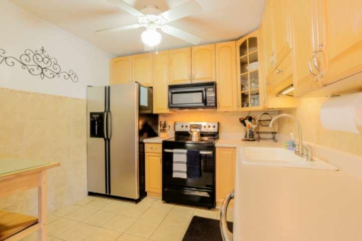 There's plenty of counter space and cabinet storage area for your food & kitchen items.