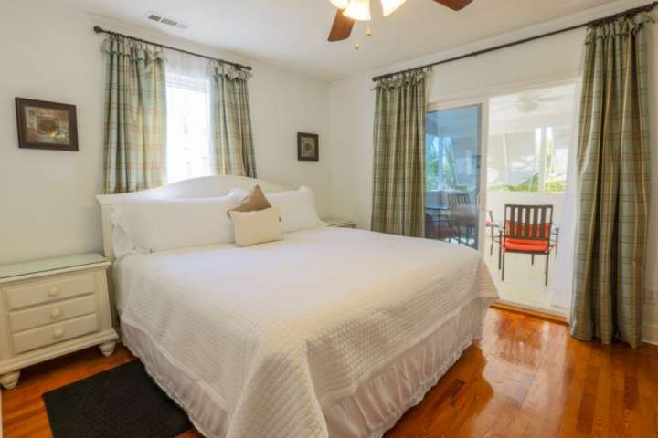 The Palm Up master bedroom features a queen sized bed, night stands and ceiling fan.