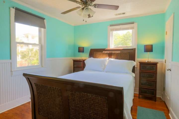 This bedroom is located right next to both of the other two bedrooms in the home.