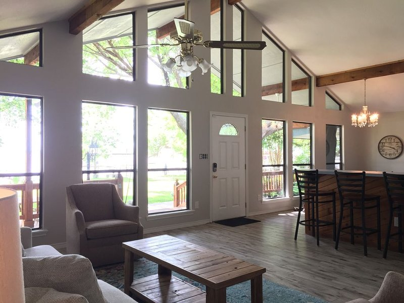 Main living area, open to the kitchen and views of the lake