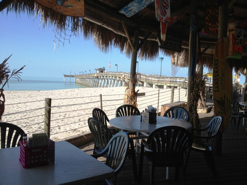 Sharky's on the beach restaurant and fishing pier.