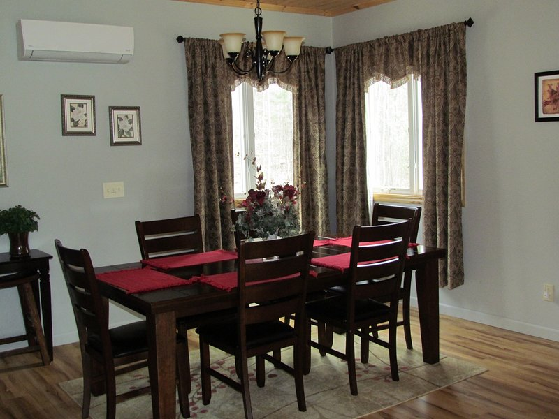 Dining area with six person table, side table, and extra seating.