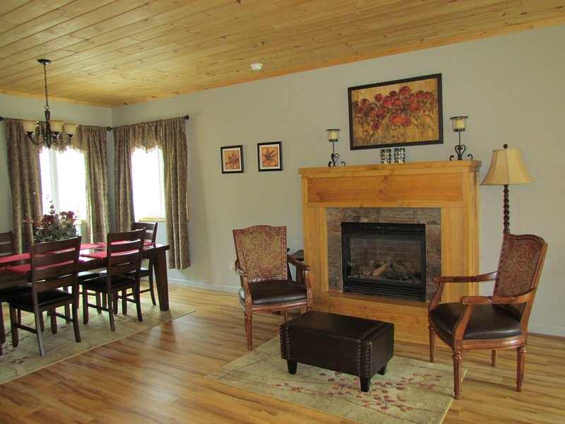 View of dining area and fireplace from reading nook.