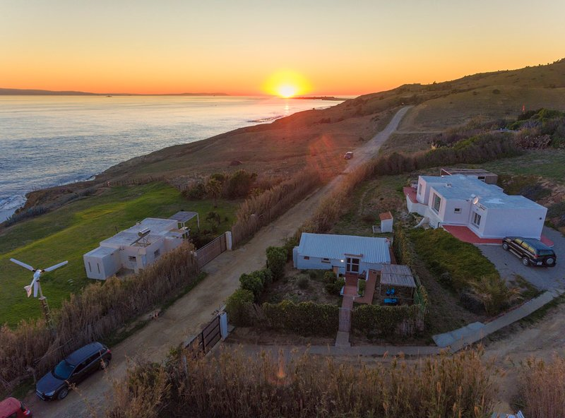 The 3 houses on the property at Sunset in winter, photo from a drone