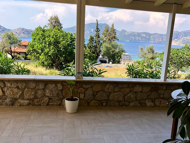 View over the Selimiye Bay with a huge fig tree in the front of the property...