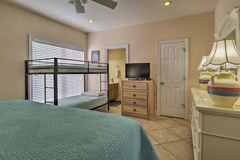 The bedroom includes a king bed and twin-over-twin bunk bed.