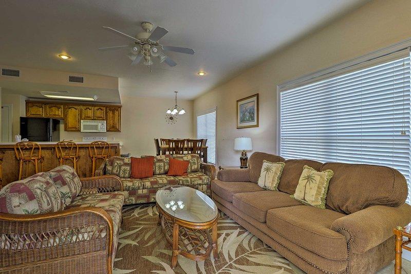 The living room boasts 3 cozy sofas.