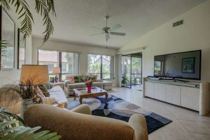 """Comfortable living area with a 55"""" flatscreen.  Enjoy movie night using the dvd player!"""