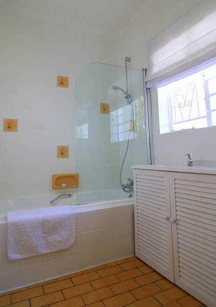Bathroom with instant shower and toilet