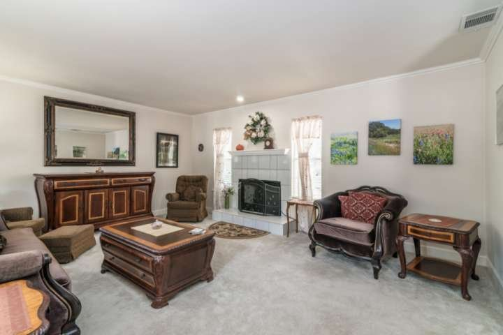Downstairs living room with fireplace (perfect spot to get cozy during the chilly winter months)