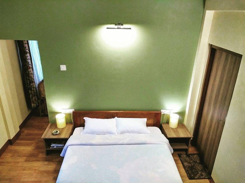 Suite 1 (Bedroom + Attached bathroom + Balcony).