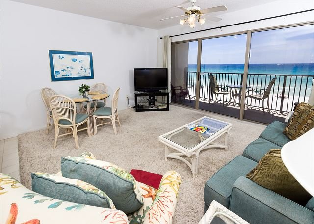 Spacious beach front living room with seating for everyone.
