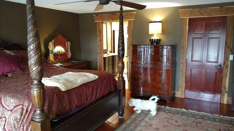 Master suite #1 very luxurious! Heated travertine floors in master bath! Antiques and message chair