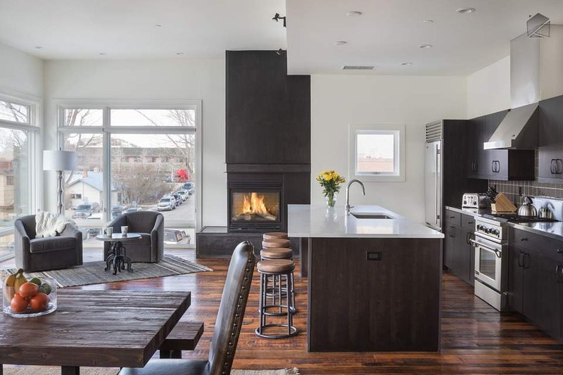 The breakfast bar is situated near the modern gas fireplace, and seats up to 4 guests.