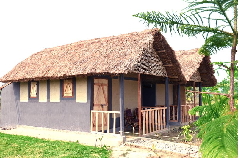 Un chalet traditionnel Assamais à Kanoka Village Resort