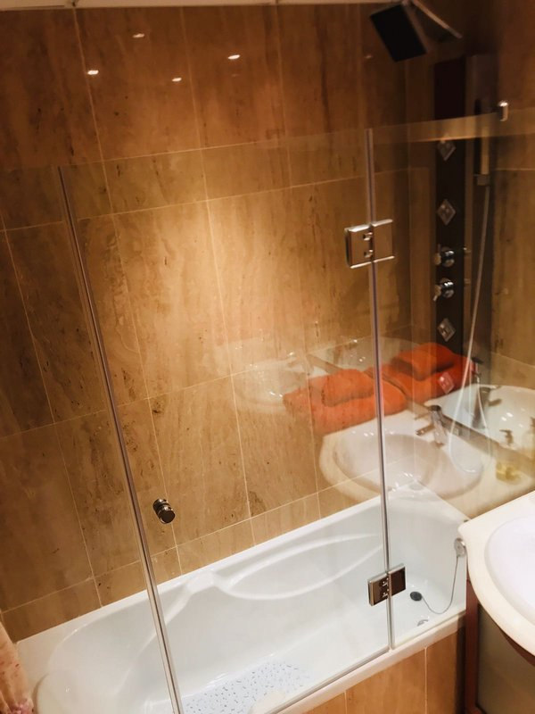 Double headed spa shower over bath