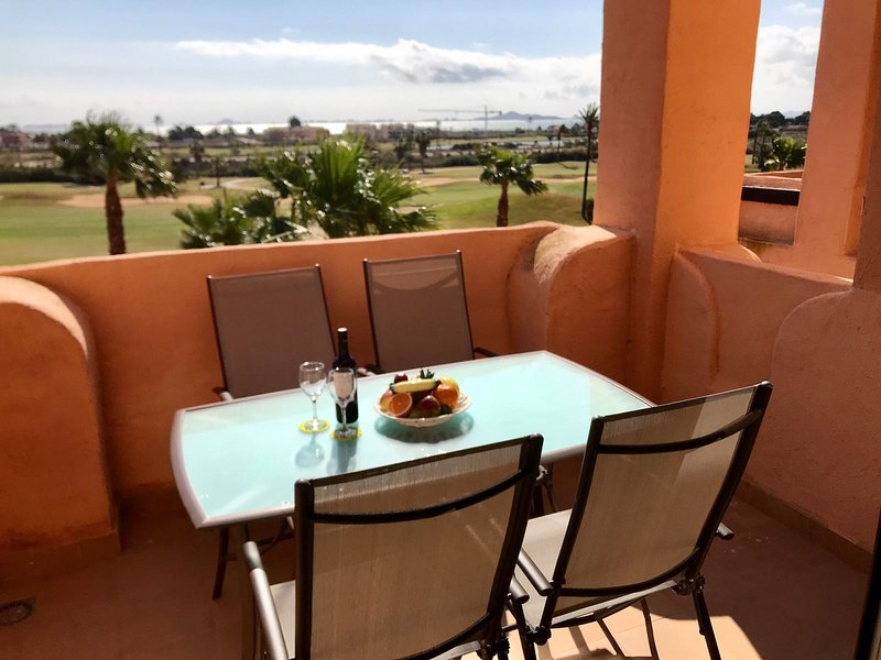 Balcony overlooking  the  golf course and mar men or.