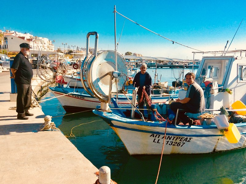 Fishermen at work at Zygi harbour. Dalla's Cyprus Retreat, Maroni village, Larnaca district, Cyprus.