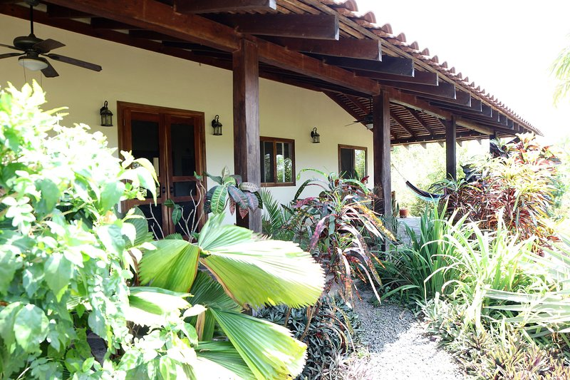 Lush, tropical gardens surround this beautiful two bedroom home in Pedasi
