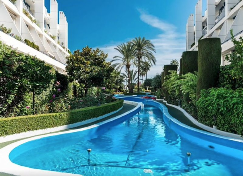 Lush surroundings of manicured gardens, fountains and pools features throughout the complex.