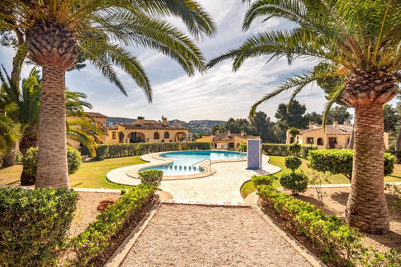 One of the 2 stunning pools and beatifully maintained gardens