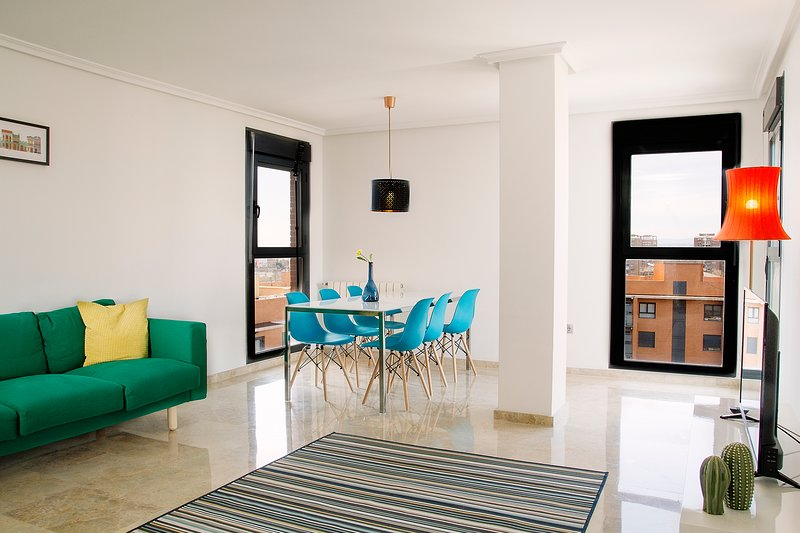 Spacious living room with dinning table.