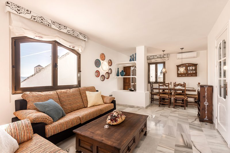 Living room with fireplace, smart TV and great views, 2 bedroom apartment for rent costa del Sol
