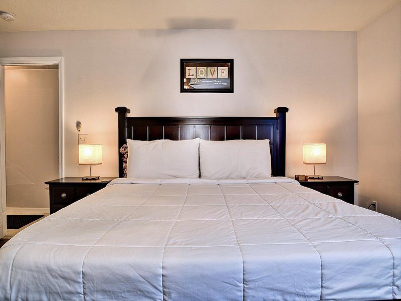 Comfy bedding in the master bedroom.