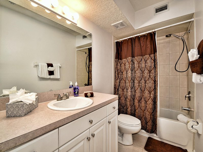 Guest bathroom has shower / tub combination.